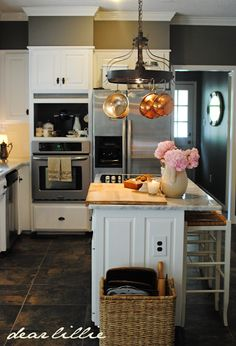 love the gray and white kitchen makeover.