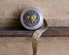 A vintage owl tape measure