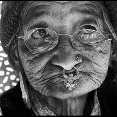 Age is only a number... the wrinkles tell you her experiences... her wisdom and the drive to draw another line on her face...