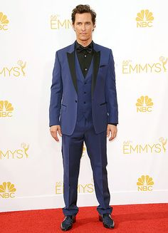 Matthew McConaughey wore a twist on the traditional tux in a navy jacket with black trim with matching pants, a black shirt and tie to the 2014 Emmys.