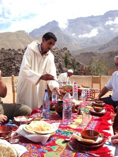 Mint leaf tea and a hearty lunch is served - with a side of a mountaintop view in Armed, Marrakech.