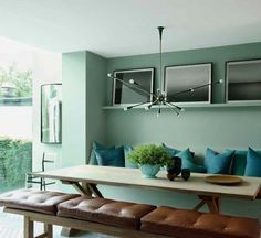 calming, natural, modern and comfy dining room. Love the natural light & the pendant!