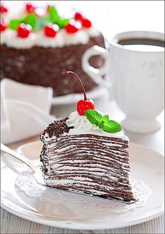 So much yum in such a small amount of space. Delectable looking Chocolate Crepe Cake. #food #chocolate #crepe #cake #baking #dessert #entertaining #wedding #elegant #delicious