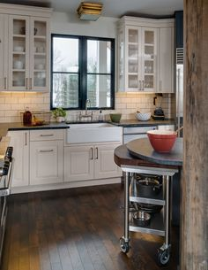 Island storage on casters with extra prep top. contemporary kitchen by Bay Cabinetry & Design Studio