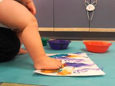 Musical Diversity! Here's an idea from the infant room at Bright Horizons Montessori at Sundance in Fort Worth TX. Music was played from various cultures and the infants kicked with excitement to the different rhythms. The beautiful paint on their feet helped them create their own unique rhythmic flags.