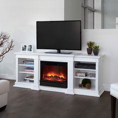 I love this!!!  $814.99 - Beautiful crisp white finish, the Fresno Fireplace functions as both a fireplace and entertainment center, holding your t.v. and equipment. - Free Shipping Camelot Living!