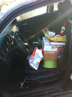 TOTALLY doing this one. Not this year...maybe next.  ;) Elf on the Shelf Fast Food Run  Our Elf took Daddy's car out over night and drove to McDonald's. We found him in the car, which was parked half in the driveway, half in the front yard, sitting on a stool, books, boxes, etc, with McDonald's wrappers, pieces of burger and fries all over the place with the car running, heat on and Christmas music blaring on the radio. He also had a gift card for our child under his arm.