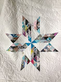 breaking clouds quilt   Like the idea of a scrappy star with lots of white...