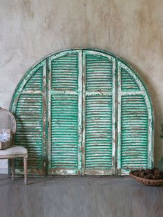 distressed painted arched shutters