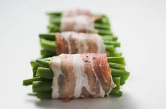 Bacon wrapped green beans with butter, brown sugar, and garlic mixture poured over them, then baked.