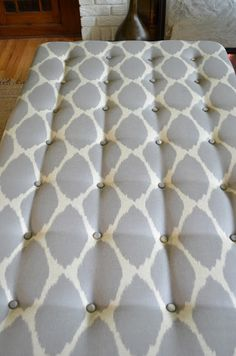 How To Tuft An Upholstered Ottoman.  Maybe this could work on piece of mdf for headboard or old ugly yard sale bed.