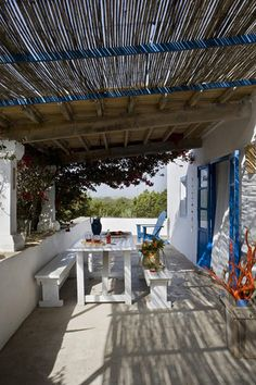 FORMENTERA HOUSE. The terrace offers an open Rustic Mediterranean style.