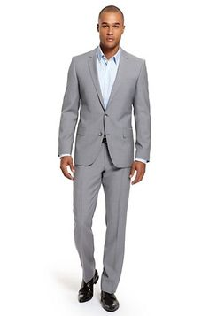 The light colored suit. Never a winter suit, better for warm weather and not on warm rainy days (dark spots not sexy). Not an evening suit unless you can carry it off, great for outdoor weddings. Light colored suits can be worn with a tie, even a dark tie, keep the shirt color scheme light, we want eyes drawn to you and your suit, distractions are not needed. Suit Hugo Boss. Again off the rack is fine get it tailored to fit your body and you will look summer GQ.    #loledeux