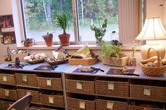 Beautiful nature display, shelving, and labeled baskets. (Primary Village, Centerville OH)