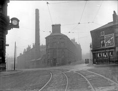 Junction of Flat Street (left) and Norfolk Strreet from Fitzalan Square, showing Joseph Rogers and Sons Ltd., cutlery manifacturers and No. 2, Elephant Inn with the clock on the General Post Office left