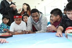 Milwaukee Bucks players and coaches joined with Sam's Hope for Literacy Foundation to host 300 Milwaukee Public School children for an afternoon of fun and learning at Discovery World at Pier Wisconsin. The children created reading-inspired murals for their schools with the help of the Bucks team and got to pick out brand new books to take home for their school libraries, donated by Sam's Hope for Literacy.