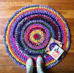 Crocheted rug from kids outgrown clothing.  I really want to make one of these!