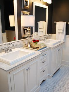 Elegant bathrooms.  Our floor tile, marble, wainscot, chrome, cabinets