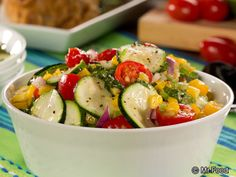 Confetti Zucchini Salad - One of our favorite summer recipes using seasonal veggies. It includes zucchini, celery, bell pepper, cherry tomatoes, corn, onion, and more!