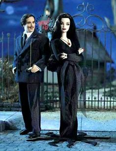 Morticia and Gomez Addams Barbie and Ken