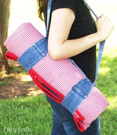 Upcycle old jeans and fabric scraps into a picnic quilt with a strap for carrying.