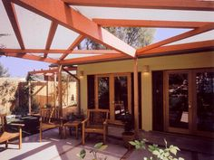 sail cloth covered pergola extends family room