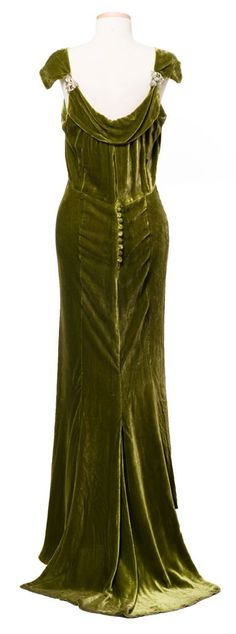 Dress with Jacket, McAvoy of Chicago (back view): ca. 1930's, bias-cut velvet, boat neckline, rhinestone shoulder clips and a short train in back and has a long sleeved jacket with batwing sleeves. charleston museum, rhineston shoulder, velvet dress, 1930s velvet, fashion, green, dresses, oliv, 1930s gown