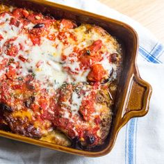 Summer casserole of eggplant slices coated in pesto and cheeses, and layered with tomato sauce lasagna-style for easy serving, by The Wimpy Vegetarian. #farmer's market