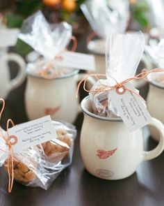 Red Wing Stoneware tulip mugs filled with a cellophane bag of homemade cookies went home with each guest. The baggies were tied with an orange string and a stamped tag noting the sweets' flavors (peanut butter and chocolate chip), their maker (Molly's mother), and that the mugs were made nearby (in Molly's birth place of Red Wing, Minnesota).
