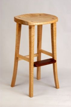 Scooped seat stool made with curly maple by Greg Aanes.