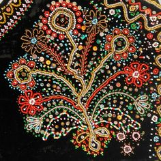 Decoration on a woman's bodice: bunch of flowers in a pot. Embroidered with beads and sequins.  Lachy Sądeckie, Trzetrzewina, P. Nowy Sącz...