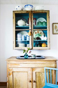 love the painted accents on this vintage kitchen cupboard