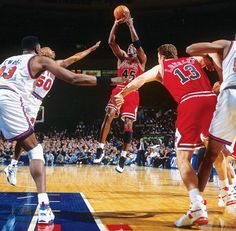 SI's 100 Best Michael Jordan Photos \\ Jordan knocks down a jumper against the New York Knicks at Madison Square Garden in March 1995.