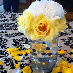 Yellow,black, white wedding centerpiece