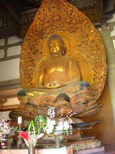 The Amida, 8-ft tall statue of the Buddha, Byodo-in Temple, windward Oahu, Hawaii