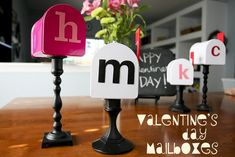 LOVE these Valentine's Day Mailboxes!  So classy and adorable!  You can recreate these inexpensively by shopping thrift stores for candlesticks (you can paint them), and old mailboxes.