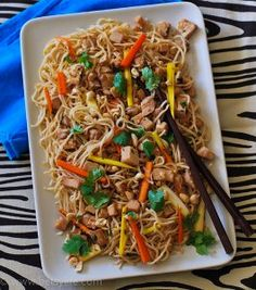 Slow Cooker Pork Tenderloin with Garlic Noodles - This recipe for Slow Cooker Pork Tenderloin with Garlic Noodles is an Asian-inspired dish that is packed with bold flavors. Slow cooker pork tenderloin is used as the meat in the dish which sits atop a bed of delicious garlic noodles. | AllFreeSlowCookerRecipes.com