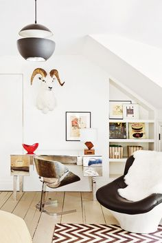 This Amazing Home is a Lesson in Sophisticated Décor// taxidermy, chrome desk, sheepskin, chevron rug