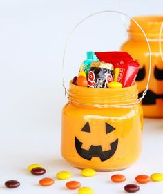 Treat-Filled Pumpkin Jars: These mini baskets are an adorable way to store tiny pieces of candy.