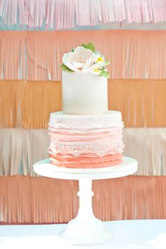 The lace on this ombre, ruffled cake is the perfect touch!