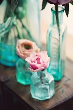 pink flowers, vintage bottles, blue, sea glass, colored glass