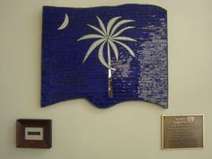 A piece on permanent display at the The City of North Augusta Municipal Building. Glass Mosaic SC State Flag. The palmetto and crescent are cut from mirror...