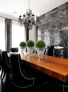 Elegant black and white dining room with marble wall