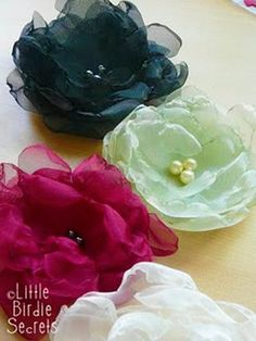 These are in, so why not make your own? http://www.skiptomylou.org/2011/03/22/10-beautiful-fabric-flower-tutorials/ fabric roses, sew, hair flower, idea, fabric flowers, crafti, organza flower, diy, thing