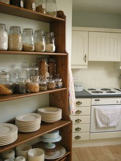 Love the soft, vintage-y feeling palette and ample storage space. #kitchen #pantry #country #chic #vintage