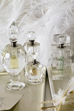 Homemade Perfume  [Perfume Bottles - Anthropologie.com]    Try goggling the ingredients in your favorite brand of perfume and play around with the same top, middle, and base notes.  Easy Perfume Recipe: http://chemistry.about.com/od/chemistryhowtoguide/a/makeperfume.htm