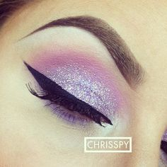 Silver Glitter with purple on eyelids and pink shadow in crease....black liquid liner on top and purple shadow on bottom lashline