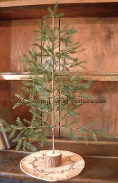 "Primitive Colonial 16"" Feather Christmas Tree available for sale on our website www.finecountrylivingprimitives.com"