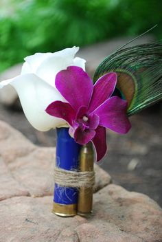 Unique Boutonniere - Shotgun Shell and Bullet Boutonniere - Rose and Dendrobium Orchid - Wedding Flowers - Avenue Blooms | Fort Collins, CO Unique Boutonnieres, Bullet Boutonniere, Avenue Blooms, Bullets Boutonnieres