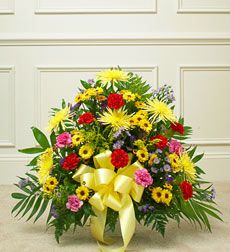 Funeral Flowers by 1800Flowers. com - Heartfelt Tribute Floor Basket Arrangement- Bright. Send a beautiful expression of your love and support during this difficult time with an arrangement of elegant bright blooms. Features fresh bright-colored roses, mums, lilies, poms, carnations, statice and more Usually sent by family, friends or business associates Delivered directly to the funeral home Our florists use only the freshest flowers available, so colors and varieties may vary Large arrangem...